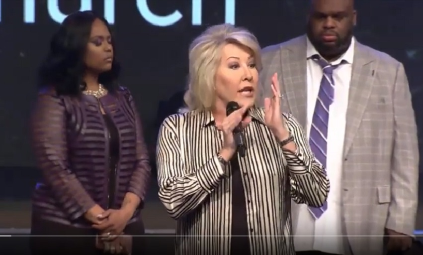 Hope Carpenter speaks at Relentless Church as John and Aventer Gray stand behind her. (Screengrab: YouTube)
