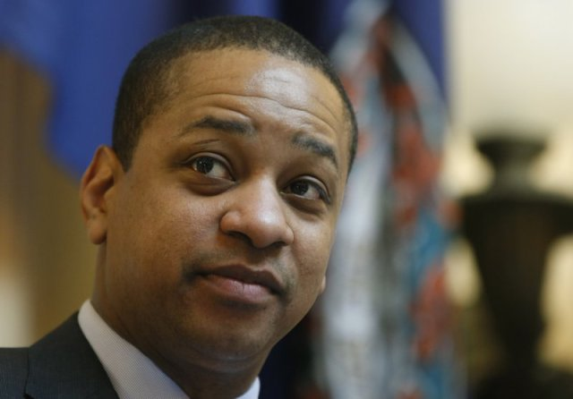"""FILE - In this Feb. 22, 2019 file photo, Virginia Lt. Gov. Justin Fairfax presides over the Senate session at the Capitol in Richmond, Va. One of the two women accusing Fairfax of sexual assault says his response has been """"disgraceful, irresponsible and manipulative."""" In an interview aired Monday, April 1 with CBS News, Vanessa Tyson criticized Fairfax for comparing himself to lynching victims when he defended himself in a speech on the state Senate floor in February. (AP Photo/Steve Helber, File)"""