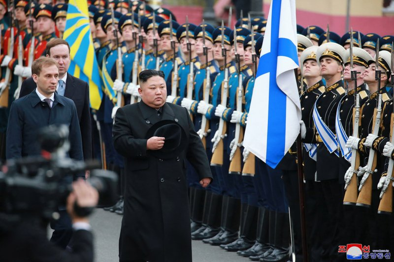 """In this Wednesday, April 24, 2019, photo, North Korean leader Kim Jong Un, foreground right, attends a welcoming ceremony in Vladivostok, Russia. The content of this image is as provided and cannot be independently verified. Korean language watermark on image as provided by source reads: """"KCNA"""" which is the abbreviation for Korean Central News Agency. (Korean Central News Agency/Korea News Service via AP)"""
