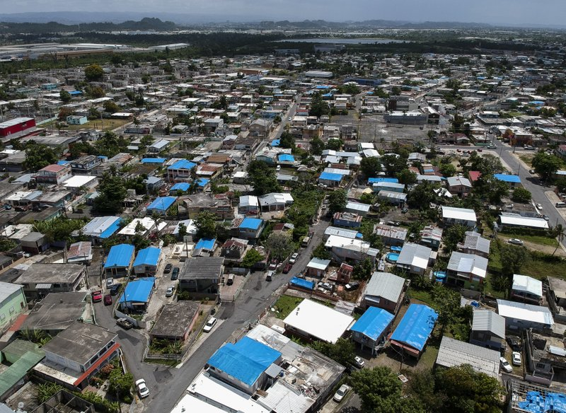 This June 18, 2018, file photo shows an aerial view of the Amelia neighborhood in the municipality of Catano, east of San Juan, Puerto Rico. The House has passed a $19 billion disaster aid bill that would deliver long-sought relief to farmers, victims of hurricanes and floods, and rebuild southern military bases. Democrats controlling the chamber are trying to dislodge the legislation from a Senate logjam over aid to hurricane-slammed Puerto Rico. (AP Photo/Dennis M. Rivera, File)