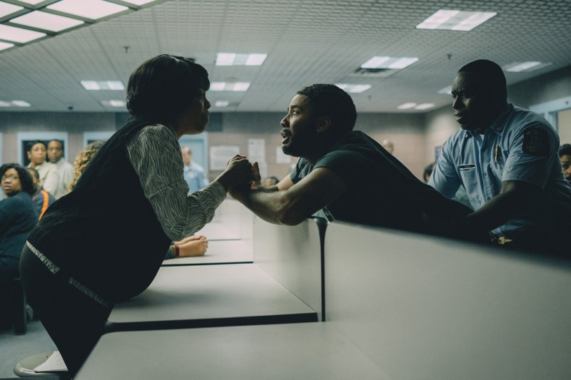 """This image released by Netflix shows Niecy Nash as Delores Wise, left, and Jharrel Jerome as Korey Wise in a scene from """"When They See Us."""" (Atsushi Nishijima/Netflix via AP)"""