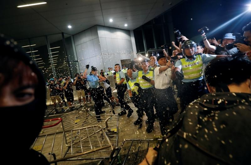 Police officers use pepper spray against demonstrators during a protest to demand authorities scrap a proposed extradition bill with China, in Hong Kong, China June 10, 2019. REUTERS/Tyrone Siu
