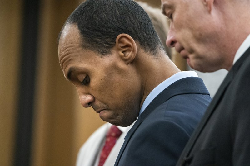 """Former Minneapolis police officer Mohamed Noor reads a statement Friday, June 7, 2019, in Minneapolis, before being sentenced by Judge Kathryn Quaintance in the fatal shooting of Justine Ruszczyk Damond. Noor, convicted of shooting an unarmed woman to death as she walked toward his cruiser says he can't apologize enough """"for taking the life of a perfect person. He sentenced Friday to 121/2 years in prison for the shooting. (Leila Navidi//Star Tribune via AP, Pool)"""