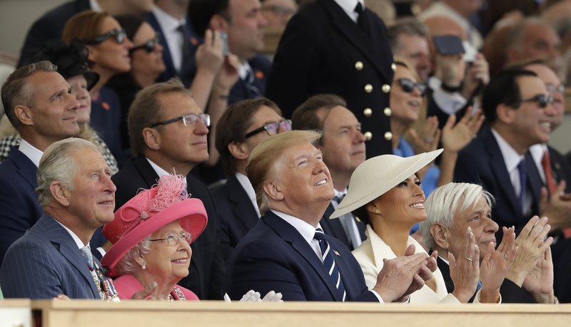 Britain's Prince Charles, Queen Elizabeth II, President Donald Trump, first lady Melania Trump and Greek President Prokopis Pavlopoulos, from left, applaud as they watch a fly past at the end of an event to mark the 75th anniversary of D-Day in Portsmouth, England Wednesday, June 5, 2019. World leaders including U.S. President Donald Trump are gathering Wednesday on the south coast of England to mark the 75th anniversary of the D-Day landings. (AP Photo/Matt Dunham)