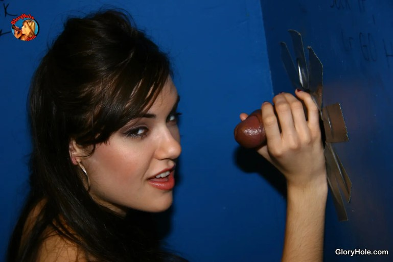 Sasha Grey Enjoys a Black Cock Glory Hole - image  on https://blackcockcult.com