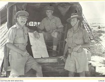 WESTERN DESERT, EGYPT. 1942-07-23. GROUP AT COMMAND TRUCK OF 20TH AUSTRALIAN INFANTRY BRIGADE IN THE BATTLE AREA WEST OF EL ALAMEIN. B.V. WILSON, is left