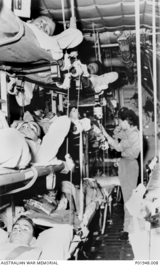P01948.008 RAAF Nursing Service tends to one of the many patients aboard a C-130 Hercules aircraft on an aeromedical evacuation flight from Vietnam