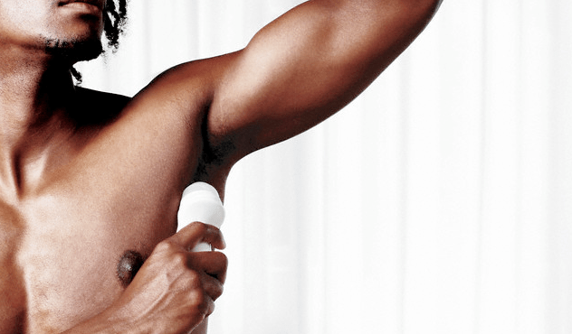 A man using deodorant