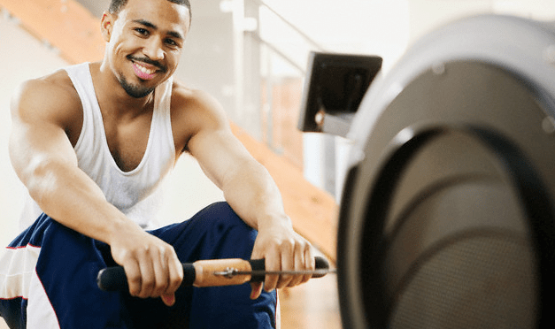 A man sitting on a rowing machine