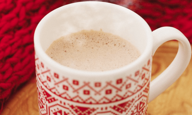 A red mug of hot chocolate