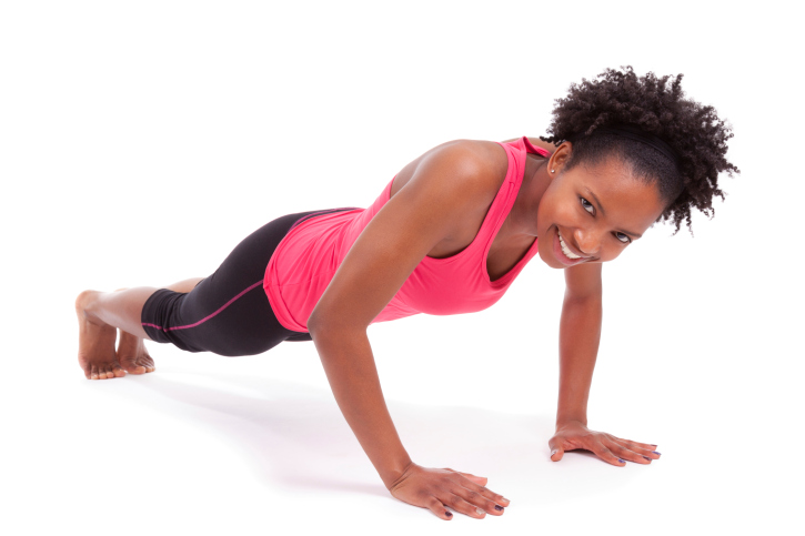 young african american woman doing push ups