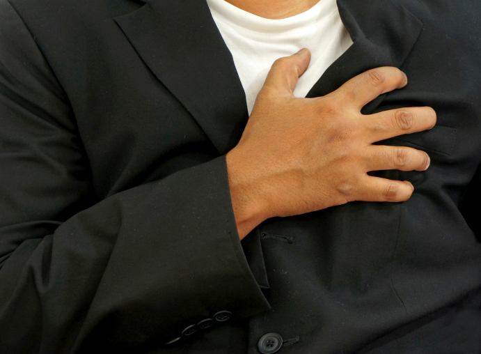 man clutching chest