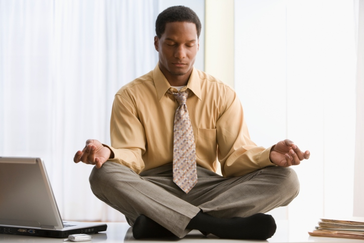 man meditating at work