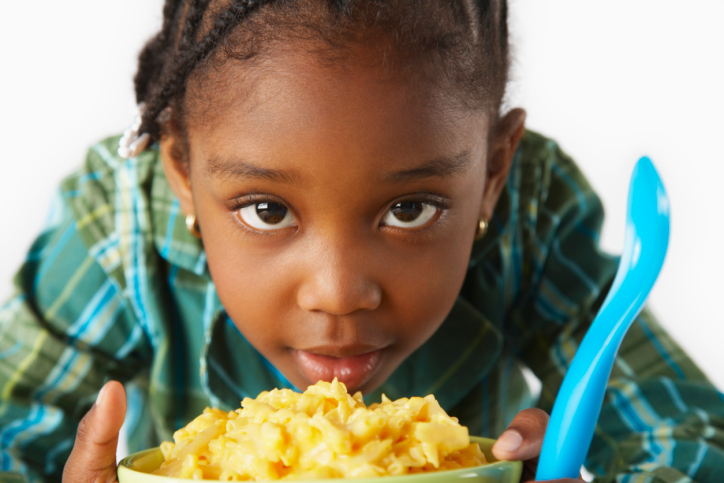 girl with macaroni and cheese
