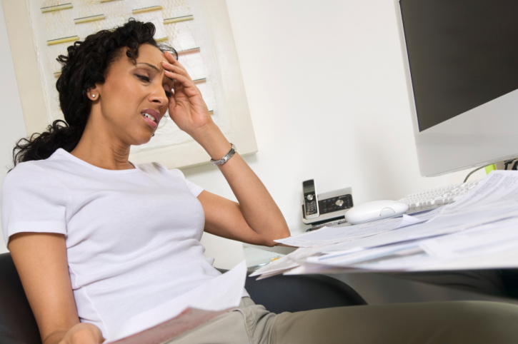 worried woman doing finances