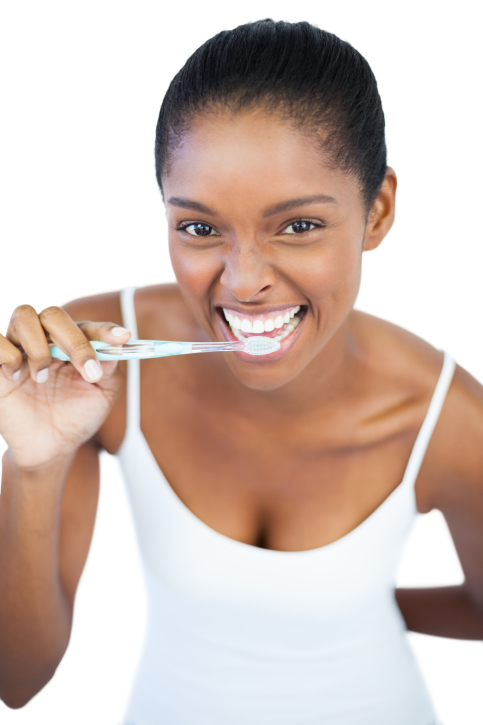 woman smiling brushing teeth