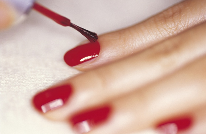 woman polishing finger nails