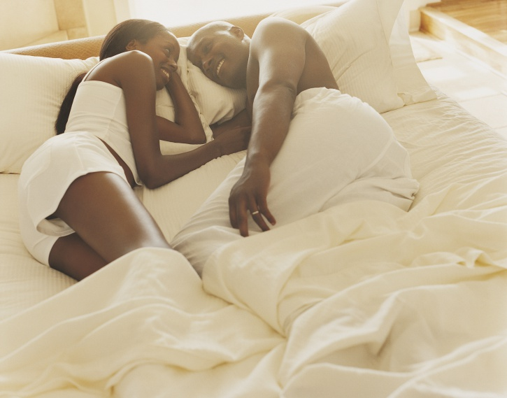 couple in bed face to face