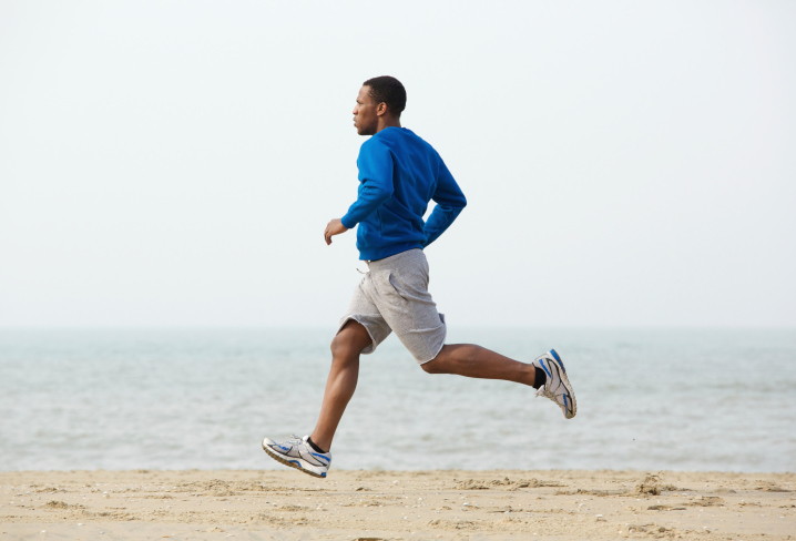 African American Black man running beach