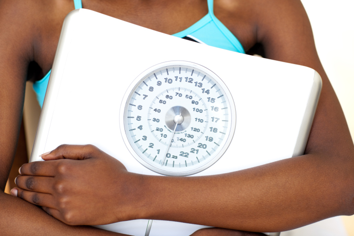 woman holding scale