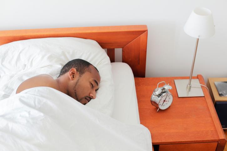 man sleeping in bed morning