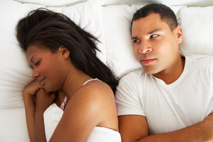 couple bed man upset