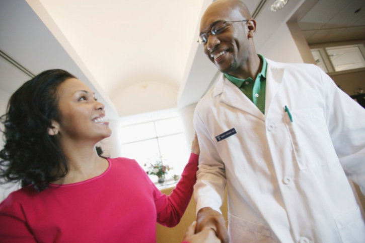 woman shaking hands doctor