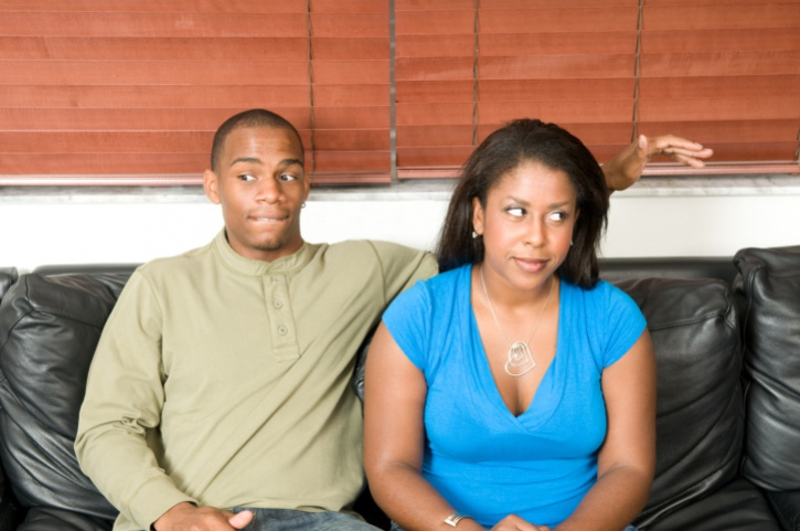 couple on couch nervous
