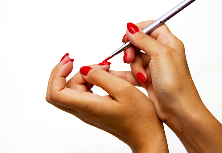 woman painting nails hands