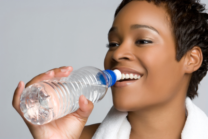 close up woman drinking bottle water