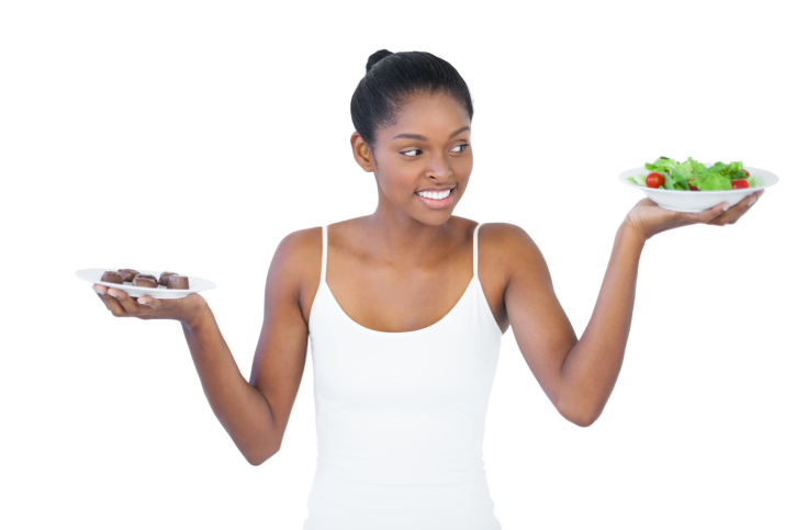 woman deciding between chocolate and salad
