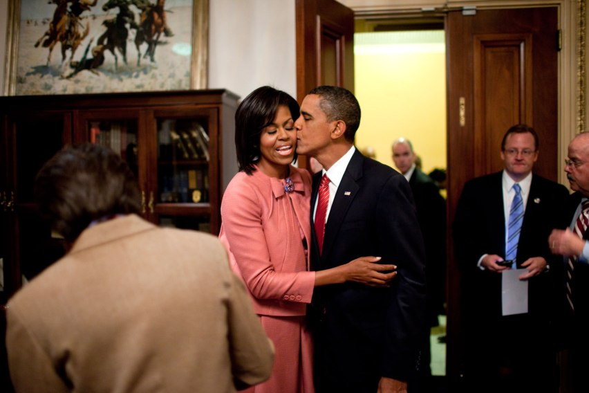 President Barack Obama kisses First Lady Michelle Obama after speaking about health care at a joint session of Congress, Sept. 9, 2009. (Official White House Photo by Pete Souza) This official White House photograph is being made available only for publication by news organizations and/or for personal use printing by the subject(s) of the photograph. The photograph may not be manipulated in any way and may not be used in commercial or political materials, advertisements, emails, products, or promotions that in any way suggests approval or endorsement of the President, the First Family, or the White House.