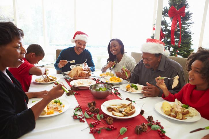 African American Black family eating Christmas dinner