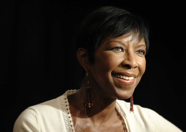 "Singer Natalie Cole looks on from the stage before signing copies of her new CD, ""Still Unforgettable,"" at Borders Westwood in Los Angeles., Tuesday, Oct. 28, 2008. (AP Photo/Chris Pizzello)"