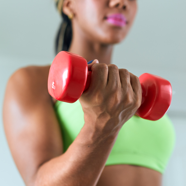 African American woman lifting dumbbell weight
