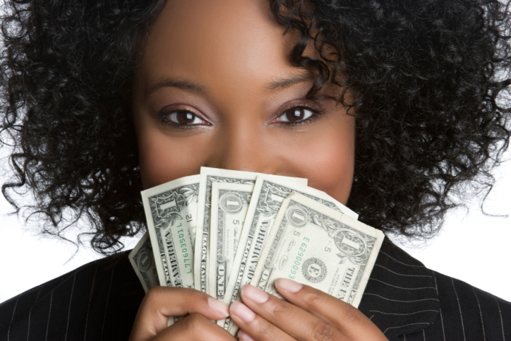 woman holding money up to her face
