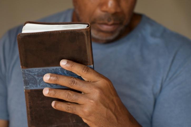 African American Black man holding bible