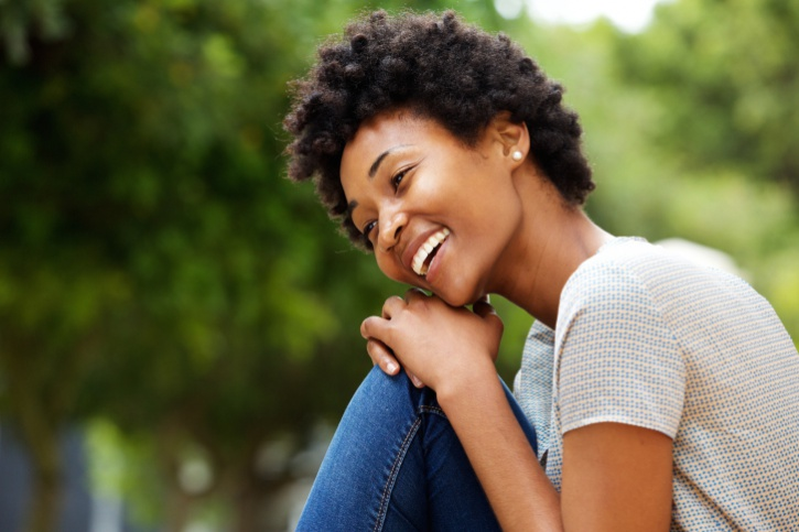 African American woman happy sitting outside