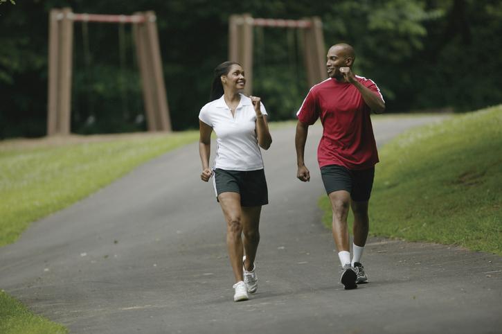 African American couple walking outside