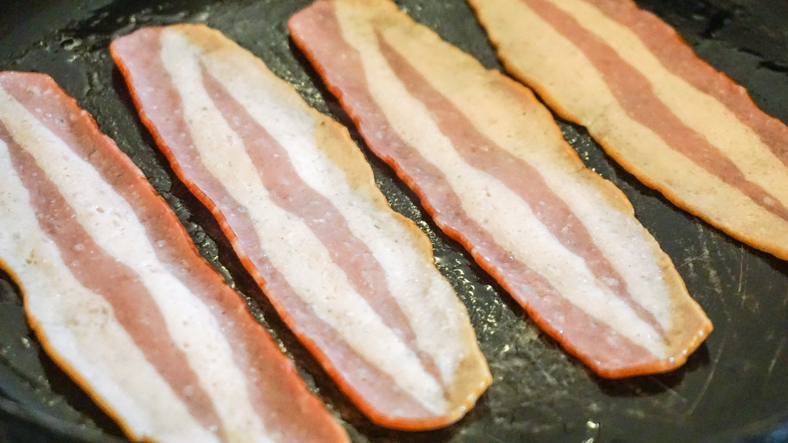 Turkey Bacon being cooked in a Pan.