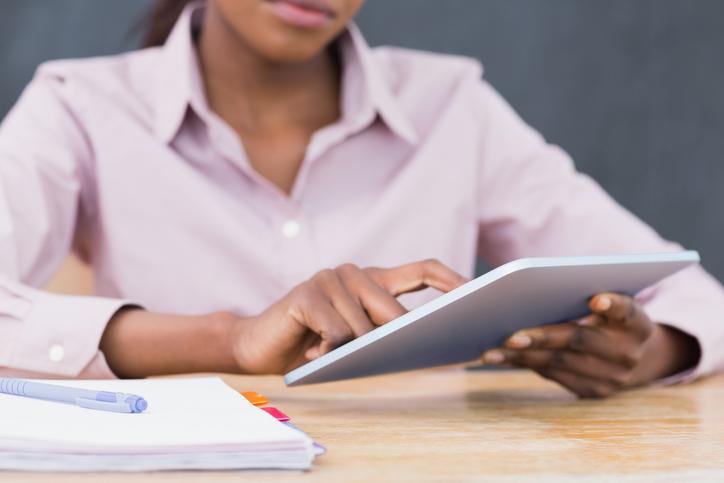 African American woman teacher using a tablet