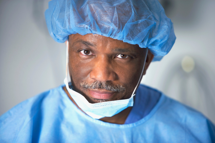 Portrait of male healthcare worker wearing surgical mask and cap
