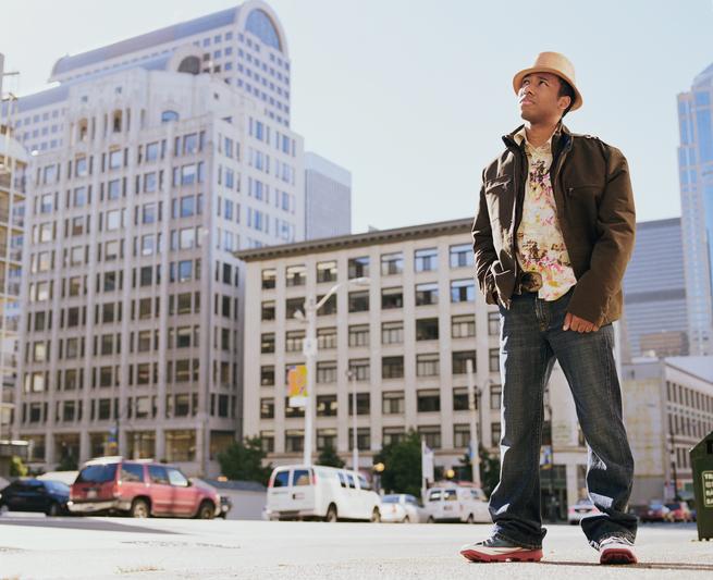 African American man standing on city sidewalk
