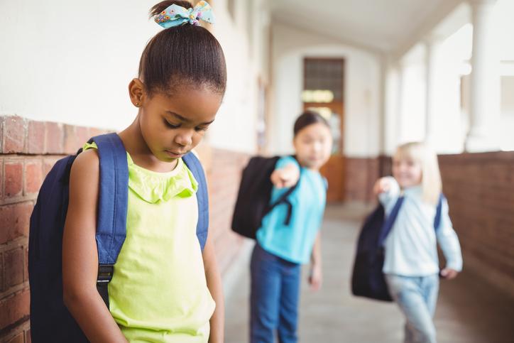 sad African American girl bullied at school