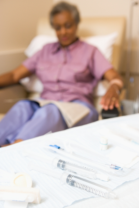 African American woman doctor office chemotherapy