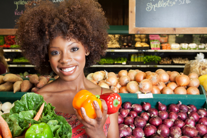 African American woman grocery store vegetables