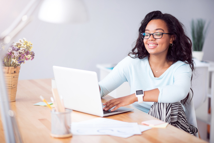 Young african american woman on laptop