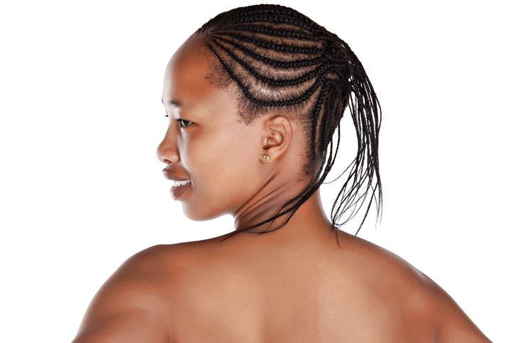 Portrait Of An Young African With Braids Isolated On White