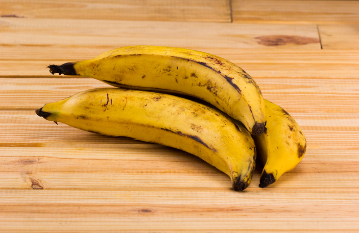 group of plantains on wooden table