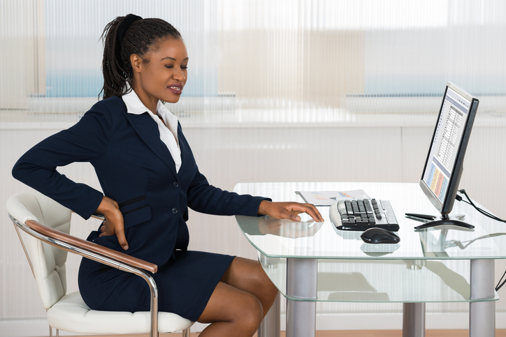 African american woman at work back pain